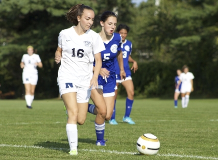 Senior midfielder Elizabeth Cianciotti pushes the offense forward for the Northport Lady Tigers.  Long Islander News archives photo