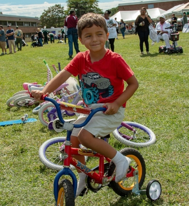 Jordan Gonzalez takes a test drive during Huntington Awareness Day.  Photo: Dana E. Richter, Dana Richter Photography