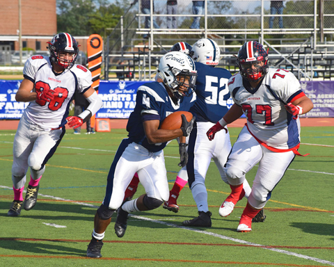 Huntington's Nasir Youngblood gains yardage for the Huntington Blue Devils during their Homecoming game.   Photos/Huntington School District