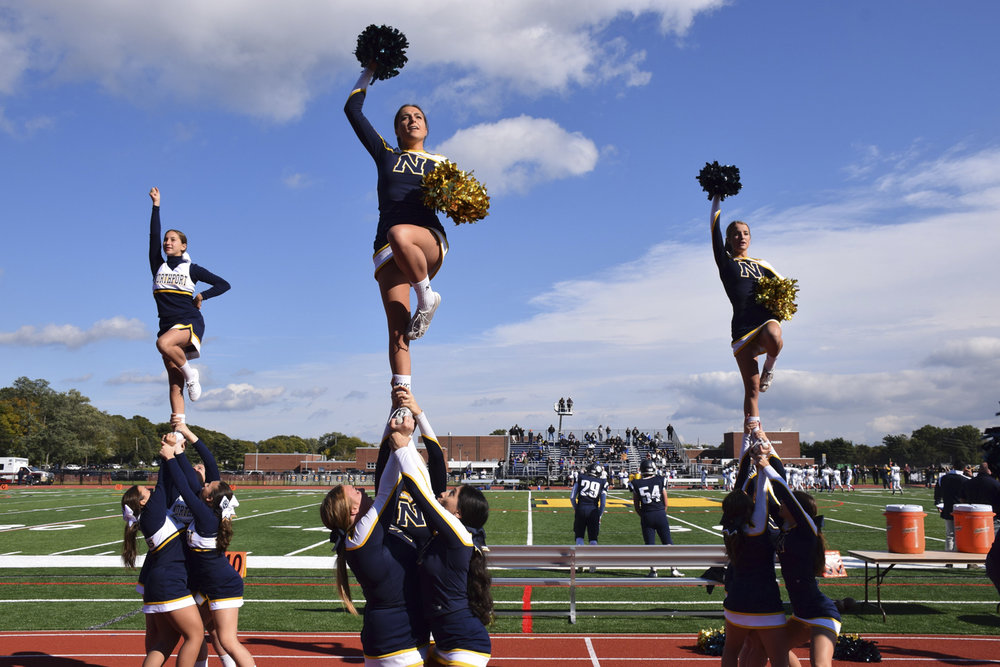 With stunts and cheers, The Northport High School cheerleading team raised the spirits of the crowd who gathered for the annual homecoming game