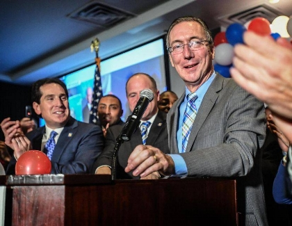 Democrat Jim Gaughran defeated 23-year Republican incumbent Carl Marcellino in the 5th New York Senate District – one of four senate seats gained by democrats to give Democrats a majority.