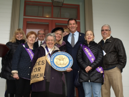 Rep. Tom Suozzi, third from right, joined local historians and members of the Long Island Woman Suffrage Association on the steps of the historic home of Ida Bunce Sammis in Huntington.