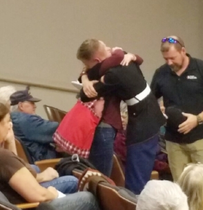 At an event organized to honor service members, two military families were surprised by their sons' returning after a yearlong deployment.