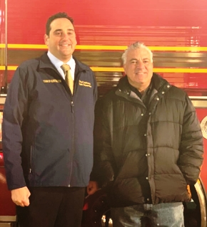 Huntington Supervisor Chad Lupinacci, left joined, Director of General Services Andre Sorrentino at the Sorrentino Turkey Drive.