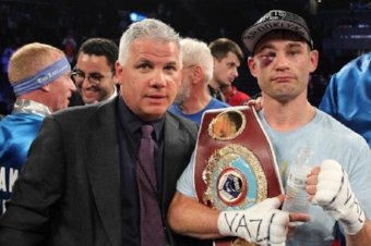Chris Algieri, right, pictured with Star Boxing promoter Joe DeGuardia after his WBO junior welterweight title fight in 2014, will return to the ring at The Paramount on Nov. 30.