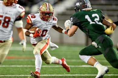 Freshman running back Dakim Griffin (#20) rushing in one of his team-leading 19 attempts against Westhampton.  Photo by Phil Orlando