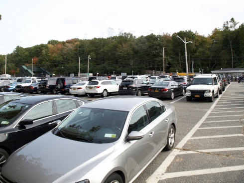 Cars fill the parking lot at the Cold Spring Harbor train station where neighbors are pushing back against a proposed 150-space parking structure.  Long Islander News photo/Connor Beach
