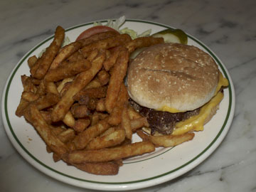 The cheeseburger with fries is among many classics enjoyed by generations at this retro eatery.