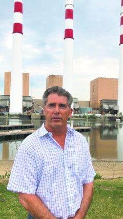 Councilman Eugene Cook, pictured in front of the Northport Power Plant in May, drummed up support from his town board colleagues to research the town's ability to acquire the plant through eminent domain.