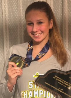 Stepanek shows off some of the hardware she brought home from the state championships.