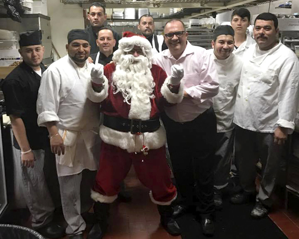 Santa and the staff at Tutto Pazzo in Halesite are gearing up for the holiday season with the return of their annual snow discounts.