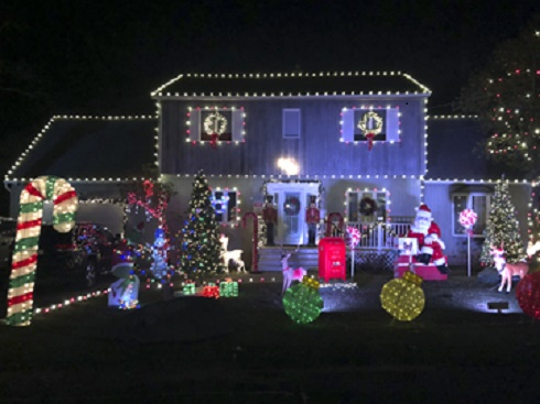 The Creegan house at 24 Wells Place, Huntington Station, won first prize in the Town of Huntington's Holiday Decorating Contest.   Town of Huntington photo/Doug Martines