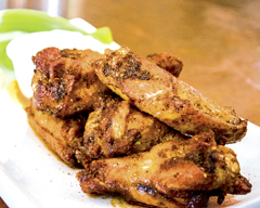 The Cajun style dry rub Wings ($8 for six) at  Brews Brothers  (69 Wall St., Huntington) are seasoned and cooked in the oven at high heat before being fried to order, a process that keeps the wings juicy and moist on the inside while retaining a crispy skin.The Cajun rub infuses into the meat of the wing that adds a depth of flavor to the dish. The wings are plump and have plenty of meat on the bone that provides a good contrast to the skin.