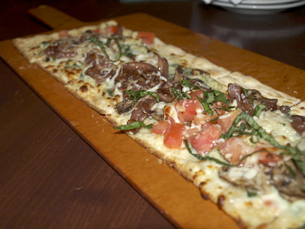 Roasted veggie flatbread ($12.49) with fresh spinach and artichoke sauce, tomato, mushroom, balsamic onions, and a mozzarella and provolone cheese blend.   Long Islander News photos/Sophia Ricco