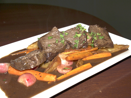 Braised short rib ($21.99) in a red wine dijon reduction with roasted carrots, radishes, and potato wedges.