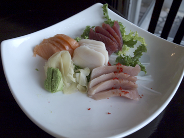 Sashimi Regular, offering a selection of fresh fish ($20)