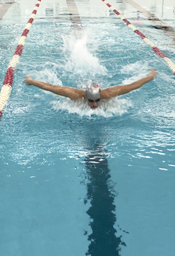 Swimmer Kabir Randhawa puts power into his butterfly stroke.