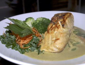 Salmon with Green Curry ($21) is rich with flavors of basil, coconut milk and Chef Marki's 'secret ingredient.'