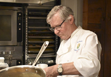 Chef Guy Reuge plates up a dish in the kitchen at Sandbar on Main Street in Cold Spring Harbor.