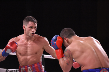 Chris Algieri, left, throws a body punch during his victory over Danny Gonzalez at MSG.  Photos/Star Boxing