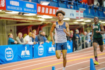 Sophomore Isaiah James runs the second leg of a relay. He won the 1000m at the Suffolk County Sophomore Championship and was the runner up at the League III Championship.