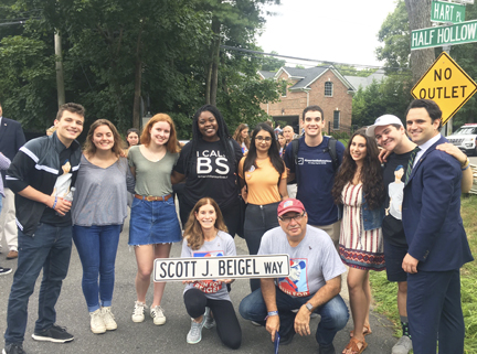 Dix Hills native Scott Beigel who lost his life trying to protect students during the Parkland shooting, was honored when the street he grew up on was dedicated to his memory. Members of March For Our Lives Long Island showed their support at the renaming ceremony.