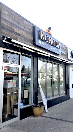 A worker installs the sign at newly opened Konoba at the former Hush Bistro. Konoba is Croatioan