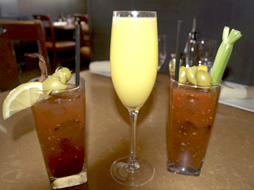 A trio of cocktails: Bourbon Bloody Mary, Prosecco Mimosa, and Traditional Tito's Bloody Mary.