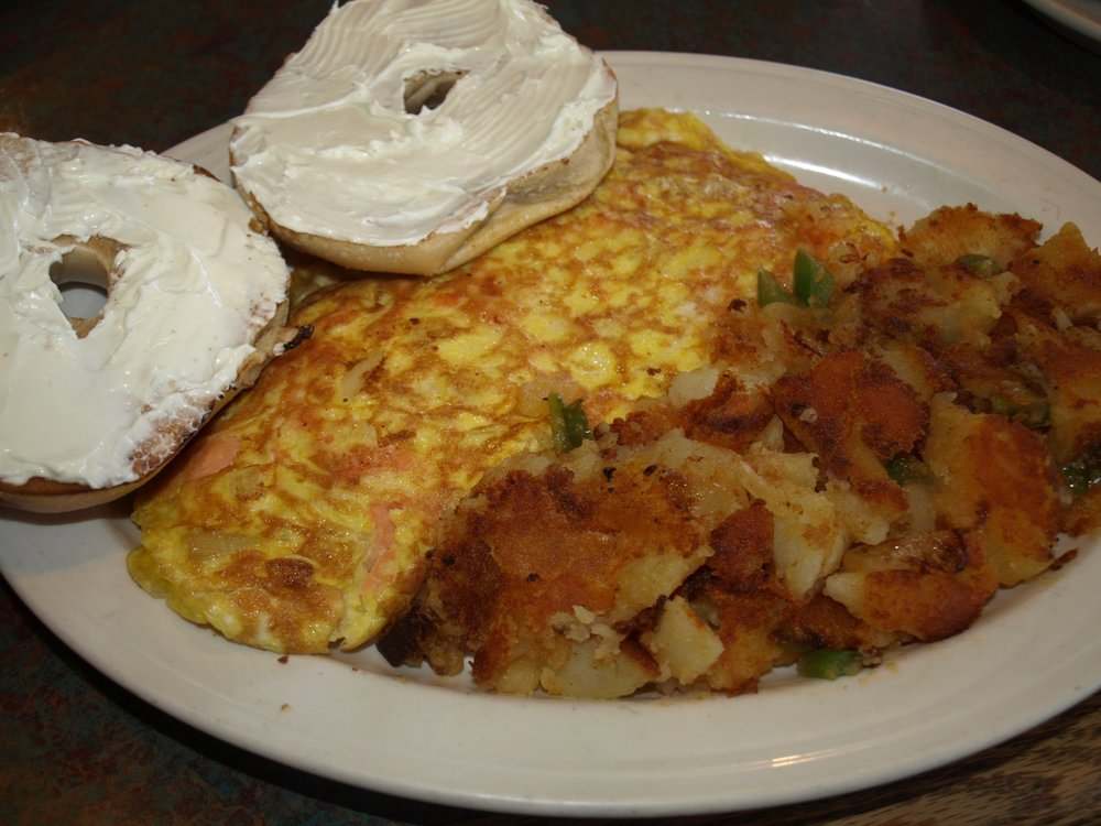 Nova lox omelette with home fries and a toasted bagel.