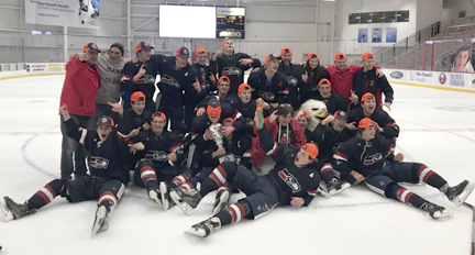 Cold Spring Harbor hockey team membs and coaches pile in for a photo after winning the Nassau championship.