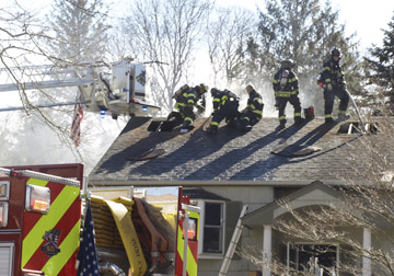 Firefighters cut holes in the roof of a home in Northport to help put out a blaze that left one person injured last week.