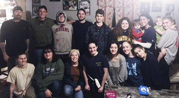 Students for 60,000 gave their time to paint the homes of three families, who had all been impacted by the opioid epidemic.