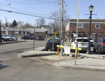 An empty space remains where a dumpster dedicated to use by local restau rants stood. Town officials ended the co-op trash program April 1 and return the space to parking.  Long islander News photo/Peter Sloggatt