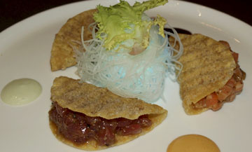 Wonton Sushi Tacos are filled with fresh tuna, salmon and yellowtail with soy mustard sauce, tomatoes, cilantro and onion.  Long Islander News photos/Sophia Ricco