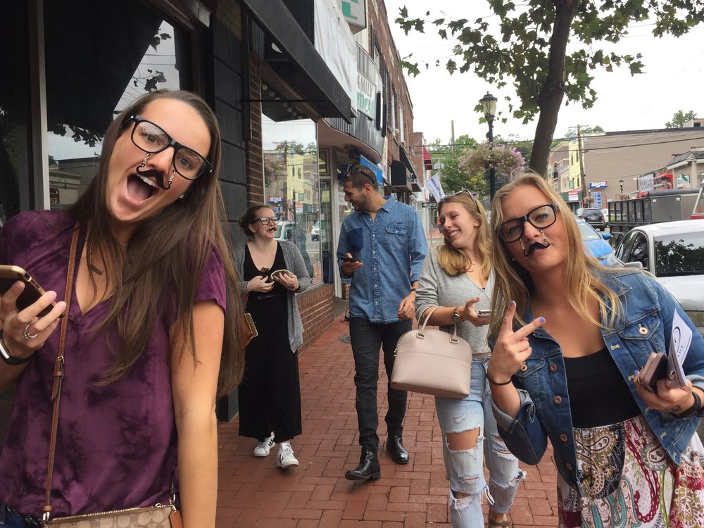 Participants in Food Done It?'s mystery dining tour solve a crime while sampling several restaurants in Huntington village.