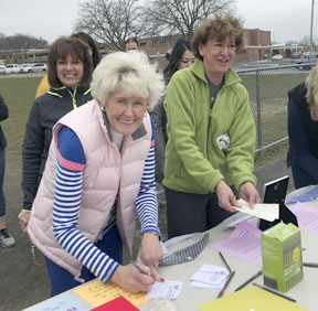 Volunteers help participants at last years Good Faith Walk on Good Friday. This year's walk will benefit St. Hugh of Lincoln's Outreach program and the Makenzie Cadmus Special Needs Trust.  Photo/Ginger Hoernig
