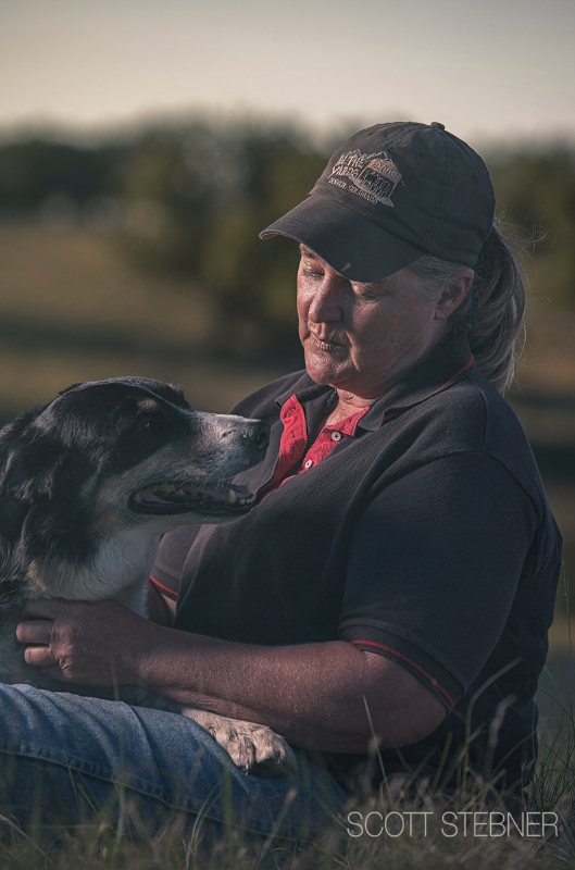 Deb takes a moment to sit down in her pasture with her most loyal companion and employee - her border collie sheep dog.