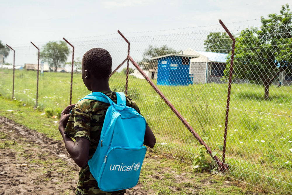 A 15-year-old boy, former child soldier on his way to school in a South Sudan town. Photo: UNICEF/Ohanesian