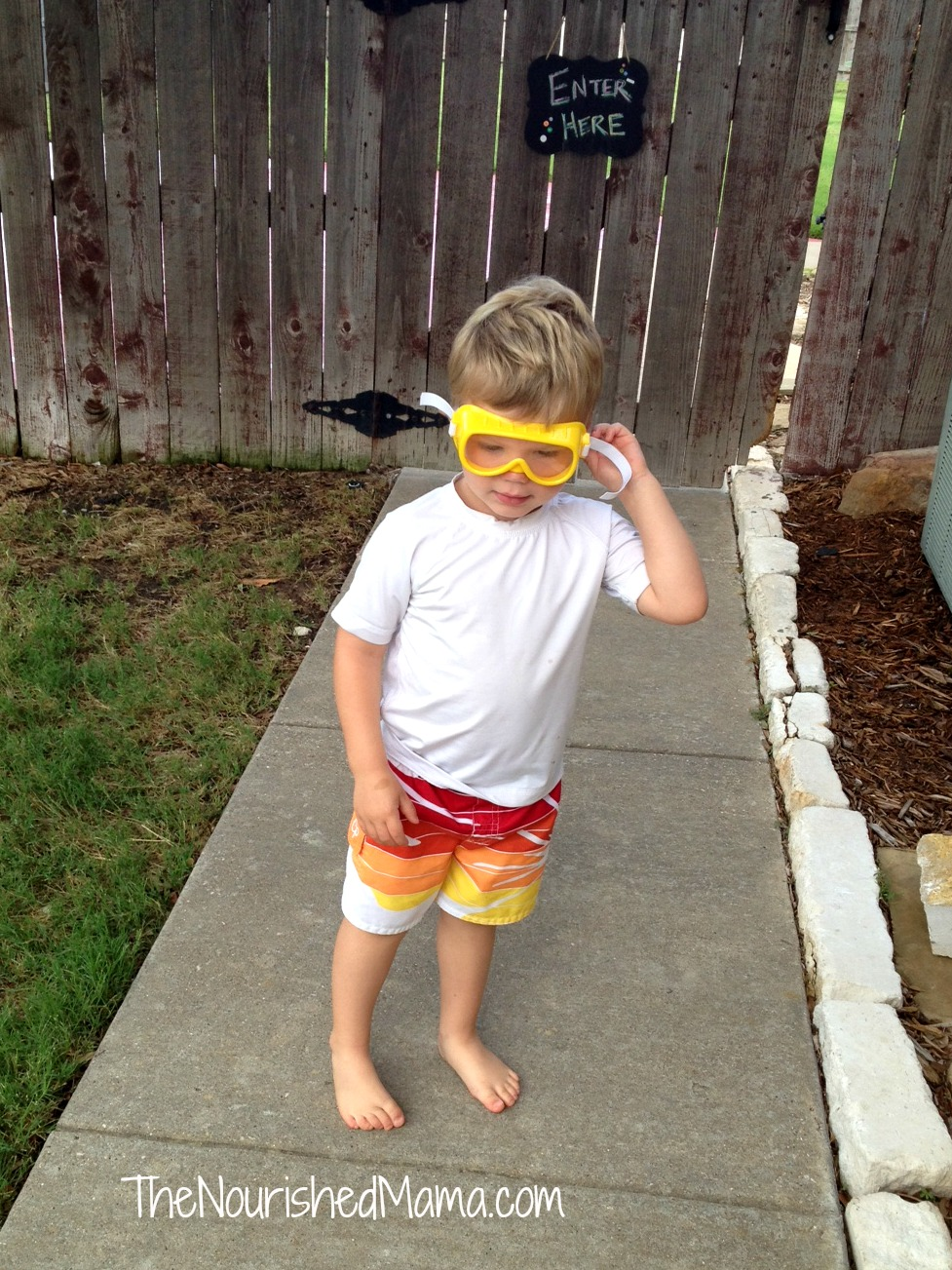 "Heading to swim with his ""goggles"" on."