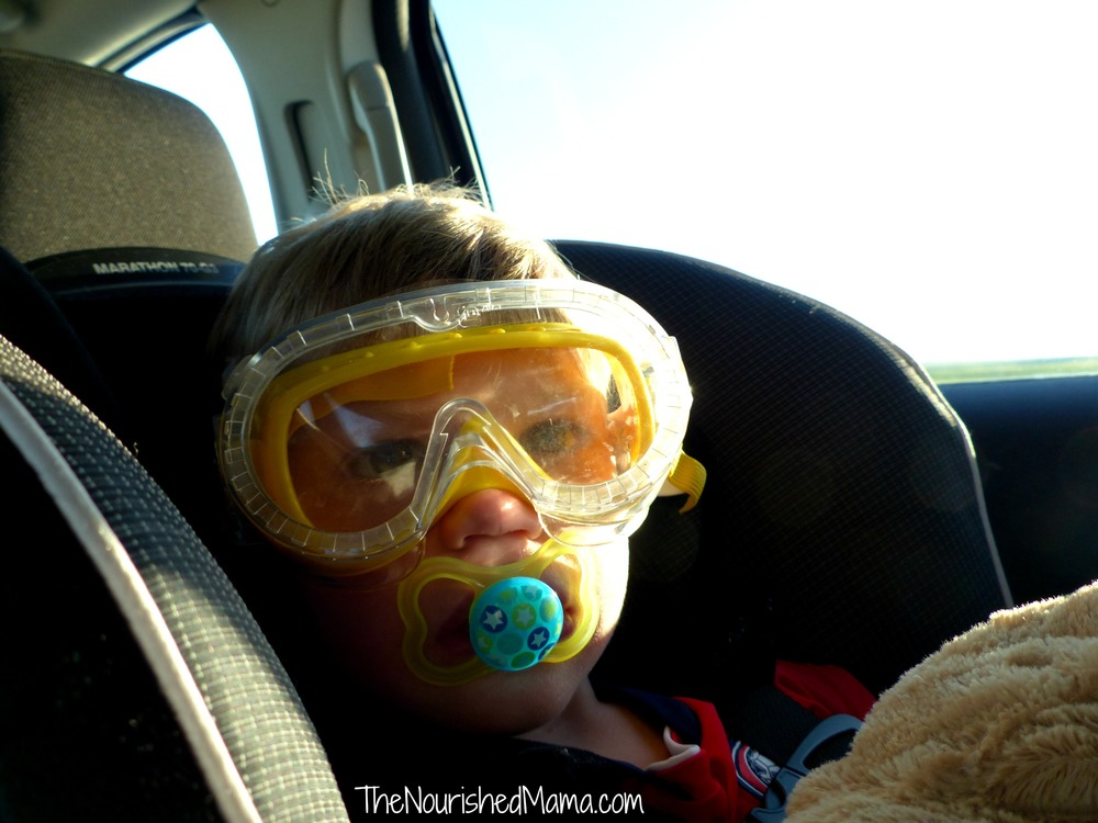 The yellow goggles were temporarily out of commission with broken elastic, so I ordered a clear pair. They both get used, sometimes simultaneously, with regularity.  Here we are road tripping from Dallas to Denver. Carseat safety is very important in this family. You can never be too careful.