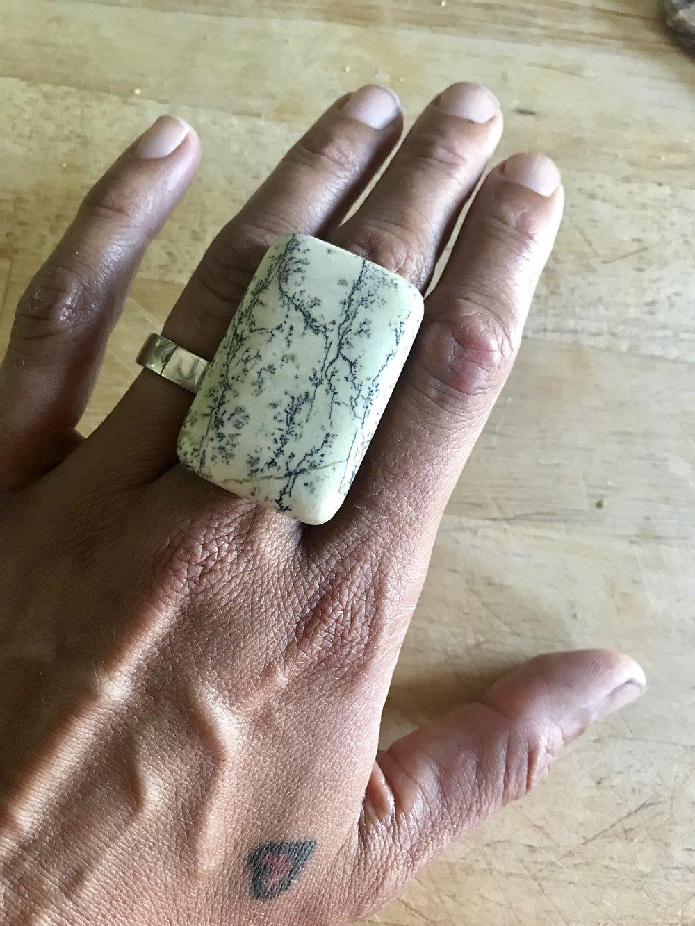 polished dendritic jasper on hand