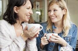 two-girls-talking-over-coffee.jpg
