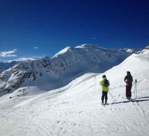 skiers moutains landscape