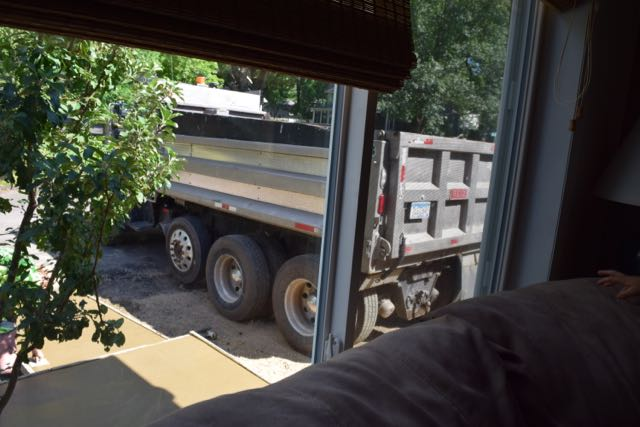 The dumptruck gets out of the way...