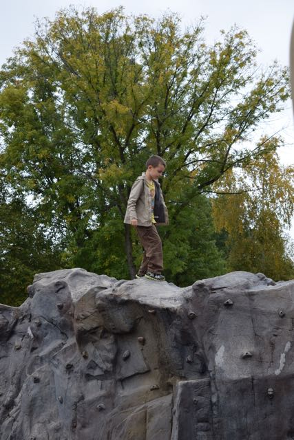 And now he's on the rock wall...