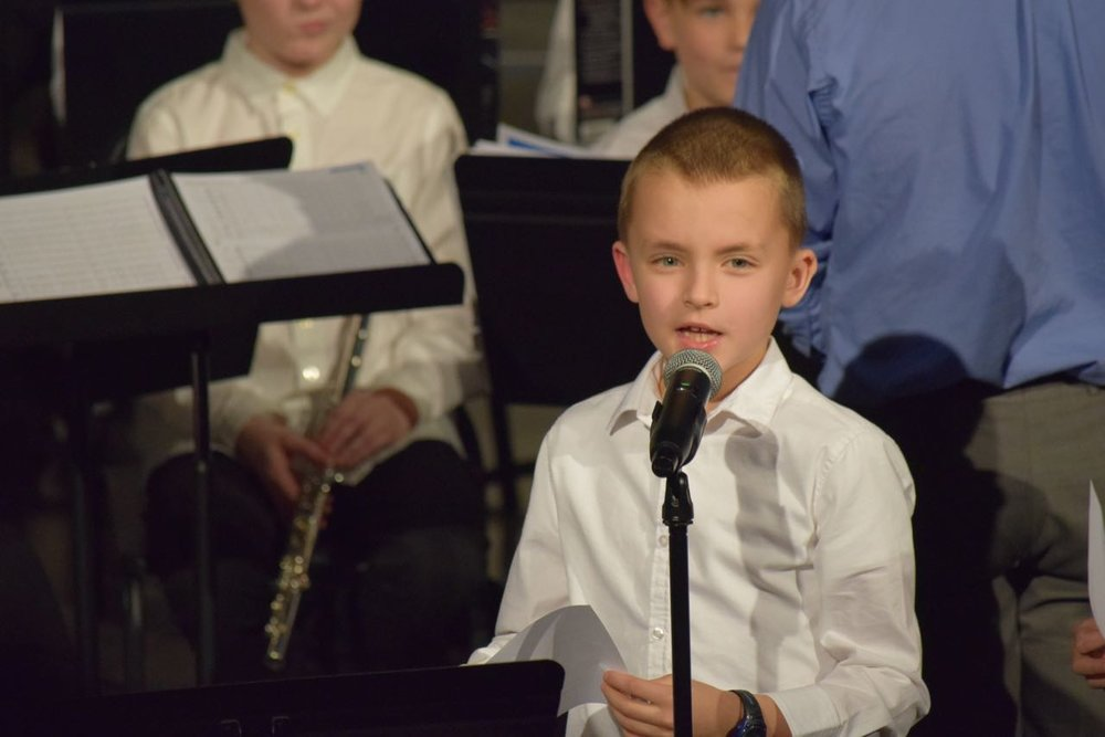 Micah speaks at his first band concert.