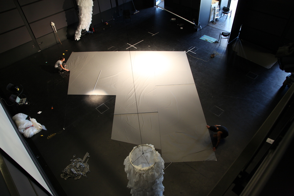 Creating canopy for giant performance pyramid for Denizen. UCSC black box, 2012.