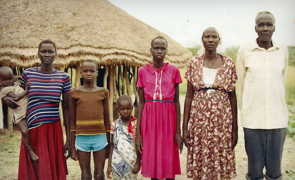 Biar (second left, blue shorts) at age seven with his family.