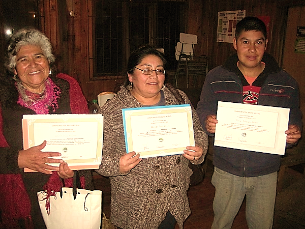 Graciela, Vicky and Pedro, the three members who received the first loans to support their initiatives.