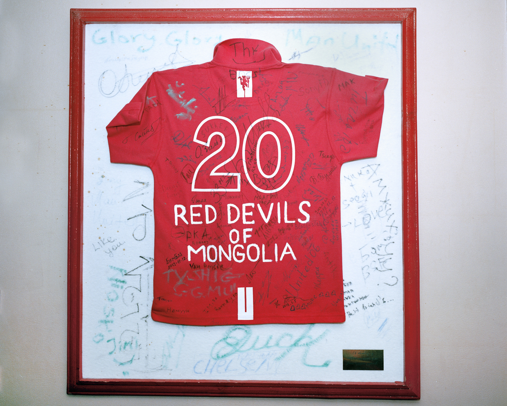 The Red Devils of Mongolia, Manchester United Supporters Group, the Manchester Pub, Ulaanbaatar, April 2014.  For years football in Mongolia was seen as a foreign game, still popular to watch however supporters entwined their lives with the rich histories of Europe's biggest clubs..